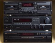 Sale 8486A - Lot 58 - A stack of Denon Precision audio Equipment inc double cassette deck DRW 585, Stereo Receiver DR-275RD, 5 Disc Automatic Disc Loading...