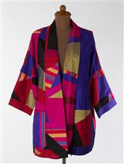 Sale 8550F - Lot 231 - A vintage MAG Designs Wearable Art 100% silk jacket in bright purple, red, olive and black patchwork colours, size M.