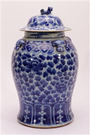 Sale 9015C - Lot 796 - Blue and white ceramic lidded jar with floral decoration (H39cm small chip to finial)