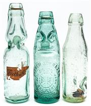 Sale 9054E - Lot 22 - An early Tooth & Co Invicta Soda bottle of pinched form bearing remnants of paper lable, together with Fisher and Frazer example and...