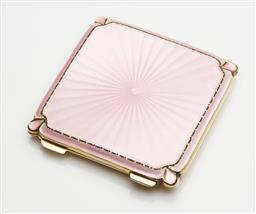 Sale 9123J - Lot 282 - An English hallmarked sterling silver gilt and pale pink enamel compact for Hardy Brothers, Albert Carter, Birmingham 1950, the guil...