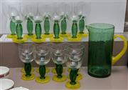 Sale 8310A - Lot 223 - A green and yellow glass drinks set, comprising a pitcher and 9 large and 7 small stemmed glasses