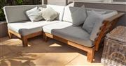 Sale 8741A - Lot 1 - An outdoor teak sofa and cushions, each section 135cm x 90cm