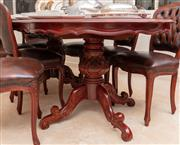 Sale 8926K - Lot 73 - A carved mahogany dining suite comprising oval extension table with butterfly leaf together with a set of eight burgundy buttoned le...