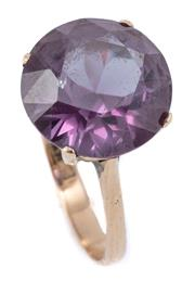 Sale 8999 - Lot 354 - A VINTAGE 14CT GOLD COCKTAIL RING; claw set with a synthetic round cut purple sapphire, top 12.4mm, size O, wt. 3.46g.