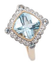 Sale 9083 - Lot 434 - A 9CT GOLD TOPAZ AND DIAMOND RING; 12mm cushion shape top centring a millegrain set chequerboard light  blue topaz of approx. 2.6ct,...