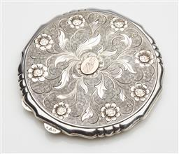 Sale 9123J - Lot 283 - A heavy Austrian hallmarked 900 silver lobe edged compact, Vienna C: 1940 with makers mark, the lid hand engraved and embossed with ...