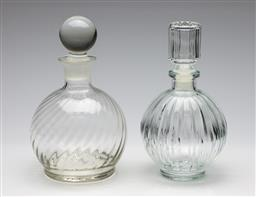 Sale 9253 - Lot 251 - A ribbed glass decanter (H:22.5cm) together with a swirl effect example (H:24cm)