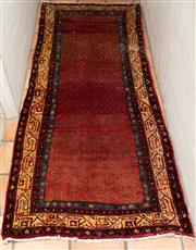Sale 8550H - Lot 192 - A Persian woollen hall runner on red ground with geometric motif to boarder, 297 x 106cm