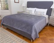 Sale 8575H - Lot 26 - A king-size bed frame and headboard, upholstered in charcoal linen, on turned feet L: 230cm W: 190cm H: 150cm to top of headbo...