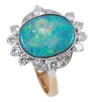 Sale 8974 - Lot 368 - A TWO TONE 18CT GOLD OPAL AND DIAMOND RING; centring an approx. 3.66ct (13.2 x 10.7mm) boulder opal with good colour range surrounde...