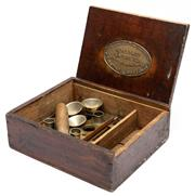 Sale 9054E - Lot 24 - Apparatus for filling and closing Morstadt Cachets, Improved and patented by Christy & Co of London. the sliding box opening to reve...