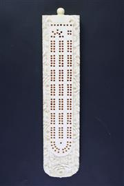 Sale 8835 - Lot 222 - A Small Ivory Cribbage Board with Parts Inside (L 21cm)