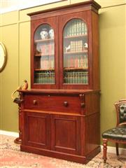 Sale 8925H - Lot 36 - An antique mahogany secretaire with bookcase over fitted desk drawer over two-door cupboard. Separates for transport, Height 238cm, ...