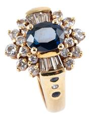 Sale 8974 - Lot 386 - AN 18CT GOLD SAPPHIRE AND DIAMOND CLUSTER RING; centring an approx. 1.1ct dark blue oval sapphire to a surround of 18 round brillian...