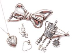 Sale 9168J - Lot 326 - FIVE ITEMS OF SILVER JEWELLERY; 2 Mexican sterling silver brooches incl a watering can attached with 4 charms stamped TV-47, size 62...