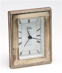 Sale 9253 - Lot 370 - An R. Carr Clockmaker England desk clock in hallmarked sterling silver frame - some brushing and scratches (H:12cm) - untested