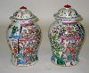 Sale 7513 - Lot 59 - A PAIR OF FAMILLE ROSE COVERED JARS.