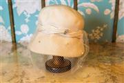 Sale 8577 - Lot 182 - A 1950s vintage bucket style woollen hat featuring satin weave band with netting and diamante brooch, Condition: good (small tears...