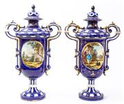 Sale 9083N - Lot 25 - A pair of continental double handled lidded urns, the cartouche displaying courtiers  (one lid restored) Height 43cm