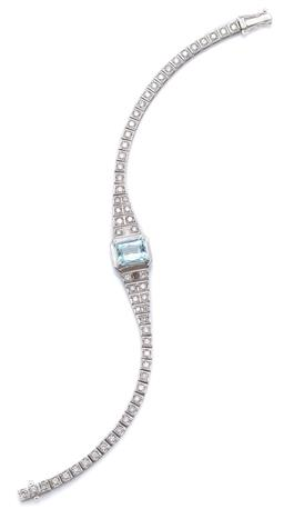 Sale 9124 - Lot 425 - A PLATINUM AQUAMARINE AND DIAMOND BRACELET; deco style centring a radiant cut aquamarine of approx. 2.17ct to tapered shoulders and...