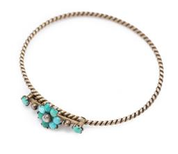 Sale 9186 - Lot 367 - AN ANTIQUE SILVER TURQUOISE BANGLE; wire twist with pivoting top bar set with a cluster of cabochon turquoise and silver bead (2 rep...