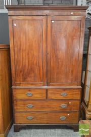 Sale 8267 - Lot 1037 - Late Georgian Mahogany Linen Press, with two doors enclosing now hanging space, above four drawers on bracket feet (some faults)