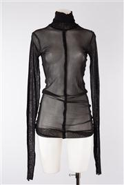 Sale 8740F - Lot 209 - A Jean Paul Gaultier Maille Femme, Italian made sheer nylon longsleeved turtleneck with exposed hems, size XL