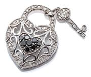 Sale 9066 - Lot 368 - A DIAMOND AND STONE SET HEART PADLOCK PENDANT; pierced heart centring a cluster of black moissanites, hasp attached with a key set w...