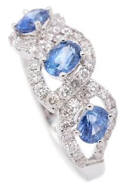 Sale 9149 - Lot 500 - AN 18CT WHITE GOLD SAPPHIRE AND DIAMOND CLUSTER RING; composed of 3 open contoured clusters each centring an oval cut blue sapphire...