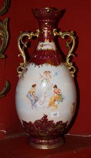 Sale 7962B - Lot 60 - Tall twin handled signed vase handpainted with cherubs and ladies in burgundy and gold