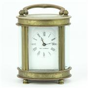 Sale 8314A - Lot 24 - French Brass Rounded Case Carriage Clock