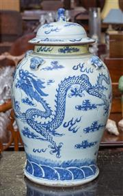 Sale 8746 - Lot 1023 - A large, late Ching blue and white porcelain covered jar, of inverted baluster form, painted with a dragon chasing the flaming pearl...