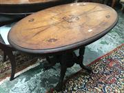 Sale 8882 - Lot 1069 - Victorian Inlaid Walnut Occasional Table, the oval top on bird-cage base with turned supports