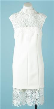 Sale 9027F - Lot 30 - A White Suede cocktail dress with lace design to front and bottom in white and cream Some make up stains to neck line size 12