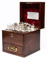 Sale 9054E - Lot 28 - A Henry Metzler travelling medicine box in mahogany with brass handles., containing an assortment of fourteen glass bottles some wit...
