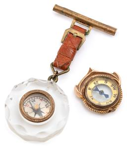 Sale 9128J - Lot 31 - TWO VINTAGE COMPASSES; one in 9ct gold surround (bale broken off), size 24 x 22mm, wt. 3.64g, other in resin surround to leather and...