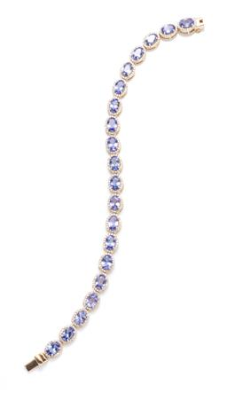 Sale 9253J - Lot 382 - A 14CT GOLD TANZANITE AND DIAMOND BRACELET; featuring 20 clusters each centring an oval cut tanzanite to surround of 20 round brilli...