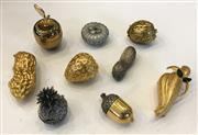 Sale 8436A - Lot 28 - A group of nine metal pill boxes of various fruit and nut designs.