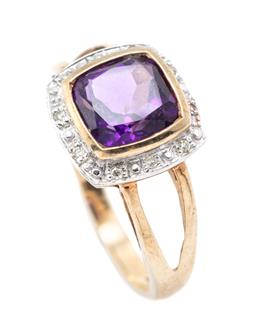 Sale 9221 - Lot 307 - A 9CT GOLD AMETHYST AND DIAMOND RING; bezel set with a cushion cut amethyst to single cut diamond surround, top 11.3 x 12mm, size O,...