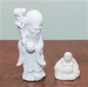 Sale 8368A - Lot 23 - A Blanc de Chine figure of a sage holding the Peach of Longevity, together with a small figure of Hotei (crazed), H of tallest 20cm