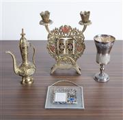 Sale 8486A - Lot 62 - A group of Judaica including a Kiddush wine goblet, double candle holder, an evil eye and a Persian brass miniature coffee pot