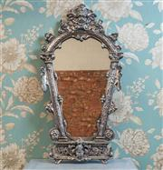 Sale 8577 - Lot 185 - A baroque vintage style silver metal cherub mantel/ hanging wall mirror featuring highly ornate detail throughout, H 76 x W 41cm, Co...