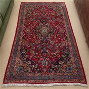 Sale 8550H - Lot 142 - A Persian rug on red ground with repeating floral motif, 185 x 98cm