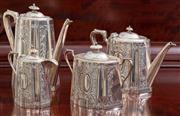 Sale 8595A - Lot 19 - An Edwardian silver plated tea and coffee service, with vacant cartouches within a scroll and lattice frame, with ivory knobs, marke...