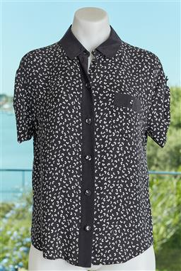 Sale 9120K - Lot 45 - A Louis Vuitton Paris collared top; with black and white design.