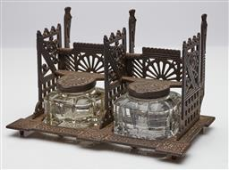 Sale 9123J - Lot 286 - An antique cast iron Secessionist period and style desk stand, double ink well with glass and iron capped ink bottles, with provisio...