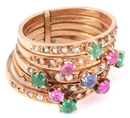 Sale 9140 - Lot 367 - A FIVE GOLD BAND GEMSET RING; 3mm wide bands set with faceted and cabochon emeralds, rubies and a blue sapphire and rose and table c...
