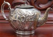 Sale 8595A - Lot 20 - A Victorian silver plated tea pot with vacant cartouche and scroll work, marked PGS, some signs of wear, H 16cm