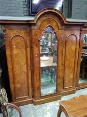 Sale 8653 - Lot 1064 - Victorian Carved Burr Walnut Breakfront Wardrobe, the central mirror door enclosing drawers & slides, flanked by doors enclosing han...